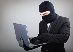 bigstock-Computer-Hacker-in-suit-and-ti-31750772